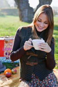 Portrait of smiling woman with cup of tea , outdoors