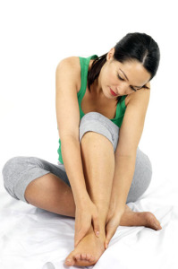 Young Woman with Ankle Injury. Model Released